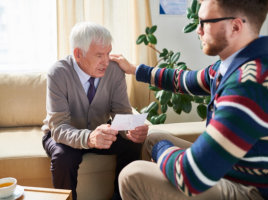 counseling session with elderly man and young man